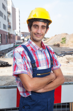 dug well: Smiling construction worker with black ha