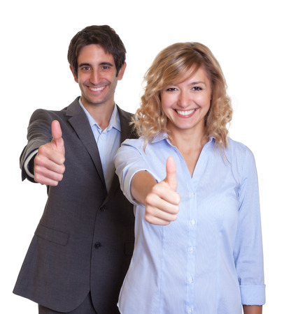Laughing latin business team showing thumb up photo