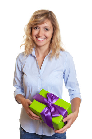 Laughing woman with curly blond hair and christmas gift photo