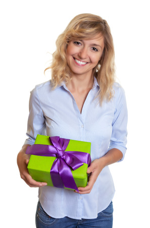 blond hair: Attractive woman with curly blond hair and birthday gift Stock Photo