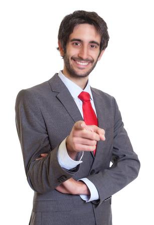 Latin businessman with beard pointing at camera photo