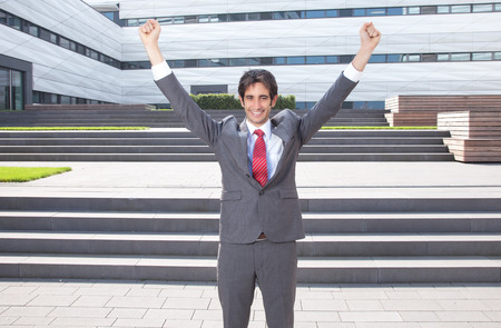 Businessman with black hair is happy about his success photo