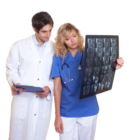 Medical team examining a x-ray photo