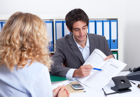 Businessman showing client details of the contract photo