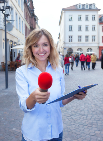 respondent: Young woman asking for opinion in the city Stock Photo