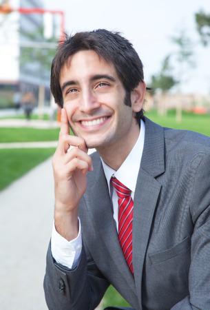 Relaxing hispanic businessman photo