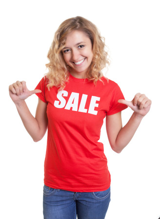 blond hair: Happy woman with blond hair in a sale shirt