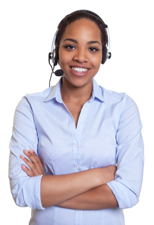 Lughing african phone operator with headset looking at camera