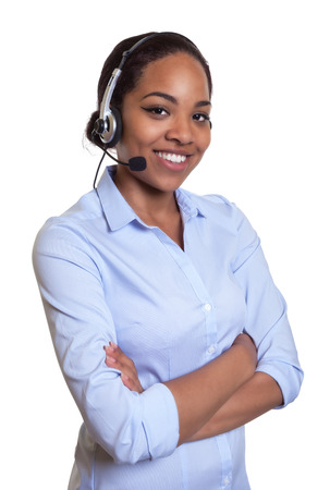 telephone saleswoman: Laughing african phone operator with headset and crossed arms