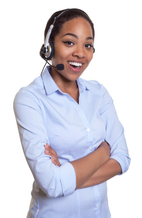 phone operator: Funny african phone operator with headset and crossed arms Stock Photo