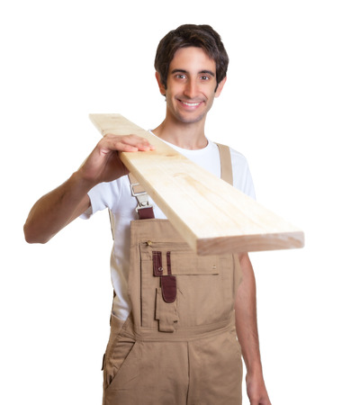Carpenter carrying a wooden beam photo