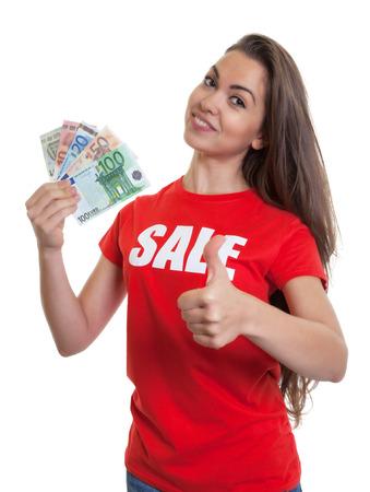 long brown hair: Woman with long brown hair in sale shirt saving money