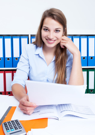 latina america: Attractive woman with blond hair and letter at office Stock Photo