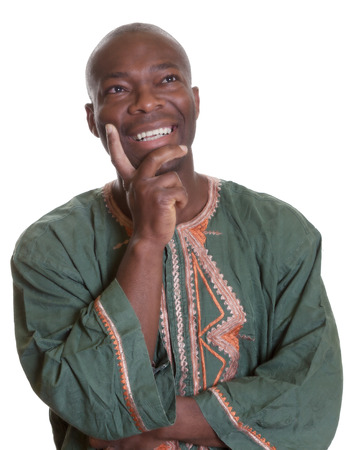 head dress: Happy thinking african man with traditional clothes Stock Photo