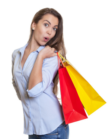 Happy woman with long dark hair and shopping bags photo