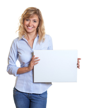 blond hair: Woman with blond hair showing a white board Stock Photo