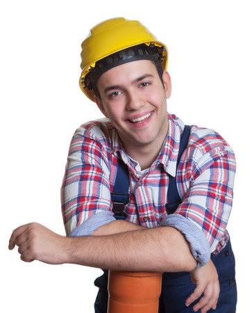 dug well: Relaxed hispanic construction worker with water pipe
