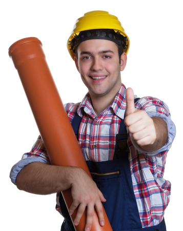 dug well: Happy hispanic construction worker with water pipe showing thumb