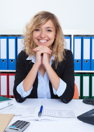 blond hair: Laughing businesswoman with curly blond hair