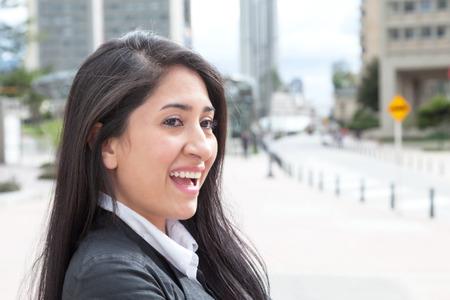 latina america: Happy latin woman in the city Stock Photo