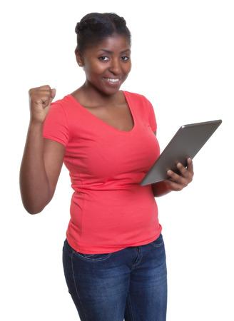 winning bid: African woman in red shirt shopping at internet Stock Photo