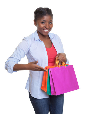 mexican woman: Happy african woman presenting her shopping bags