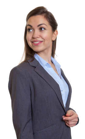 looking around: Smart businesswoman with brown hair looking around Stock Photo