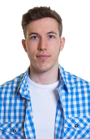 Passport picture of a guy in a checked shirt