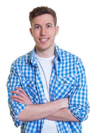 Laughing guy in a checked shirt with crossed arms