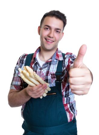 farme: Giovane farme con asparagi bianchi mostrando thimb