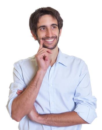 looking sideways: Thinking latin guy with beard looking sideways