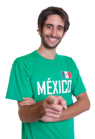 freak out: Pointing mexican sports fan with beard Stock Photo