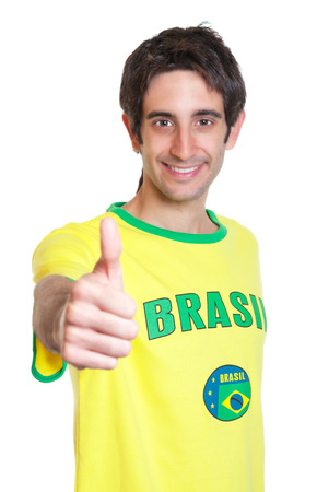 Brazilian man with short black hair showing thumb up
