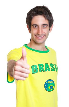 černé vlasy: Brazilský muž s krátké černé vlasy ukazuje palcem nahoru