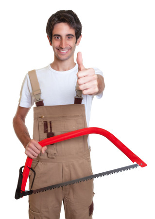 Carpenter with saw showing thumb up photo