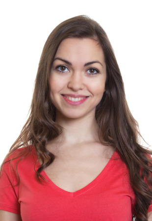 Passport picture of a woman with long dark hair and red shirt