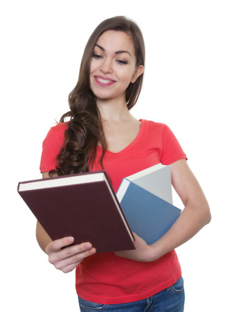 long dark hair: Female student with long dark hair looking at a book