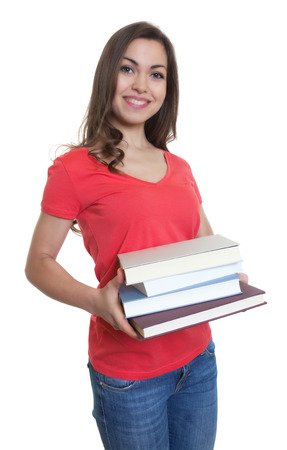 long dark hair: Laughing female student with long dark hair looking and books