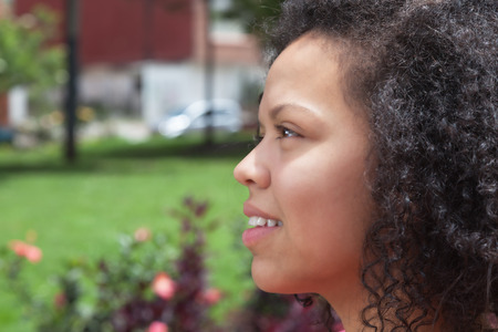 latina america: Thinking colombian woman outside in a park