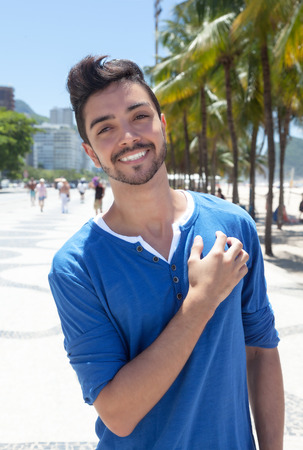 young man short hair: Attractive brazilian guy standing at Aveniada Atlantica at Rio de Janeiro Stock Photo