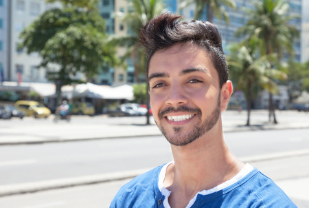 Laughing brazilian guy in a modern city photo