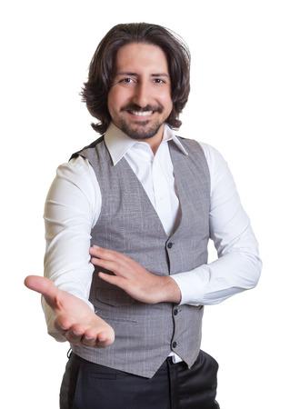 invitando: Hombre �rabe moderno que invita a sus hu�spedes Foto de archivo