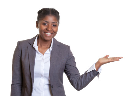 Presentation of a laughing African business woman Stock Photo