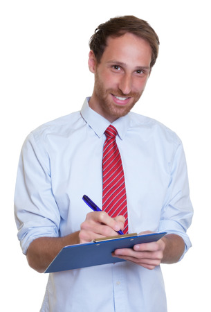 Laughing german businessman with clipboard photo