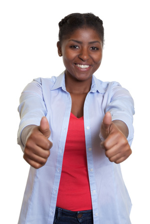 Laughing african woman showing both thumbs up photo