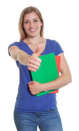 German student in a blue shirt showing thumb up photo