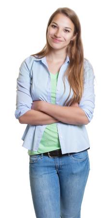 cabello rubio: De pie mujer con el pelo rubio y ropa casual Foto de archivo