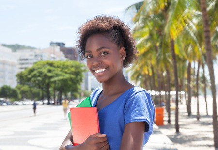 african student: Beautiful african american student in the city
