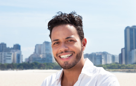 serene people: Modern brazilian man with skyline in the background Stock Photo