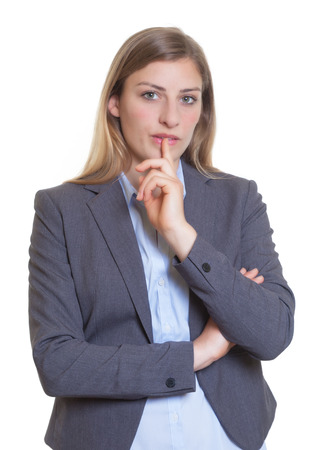 Skeptical blonde businesswoman in a blazer photo